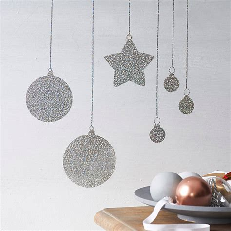 glitter baubles wall sticker by nutmeg