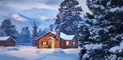 a snowy cabin next to rocky mountain national park
