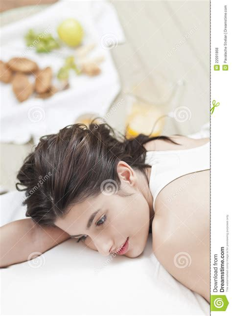 food in the bedroom worried woman on bed with food in the back royalty free stock photos image 22091868