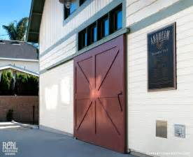 Sliding red barn door traditional exterior los angeles by real