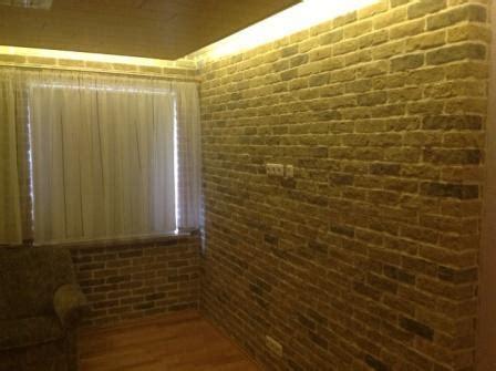 beleuchtung natursteinwand 10 ideen f 252 r eine steinwand im wohnbereich fliesen fieber