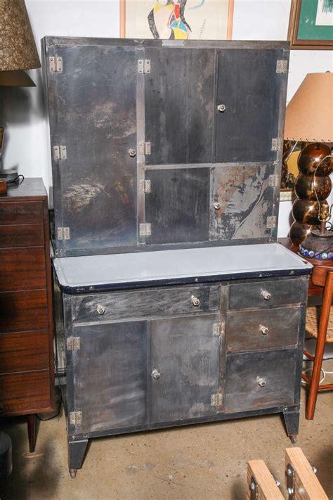 """1930's """"Packer"""" rolling Metal Hoosier Cabinet at 1stdibs"""