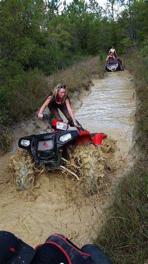 mudding four a woman riding a honda so very cool thank you for