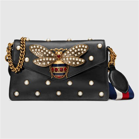 Gucci Amelia Gg Bee Cluth gucci gift guide 2016 spotted fashion