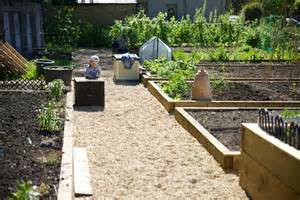 Small tool sheds for plot holders and the site is busy with activity