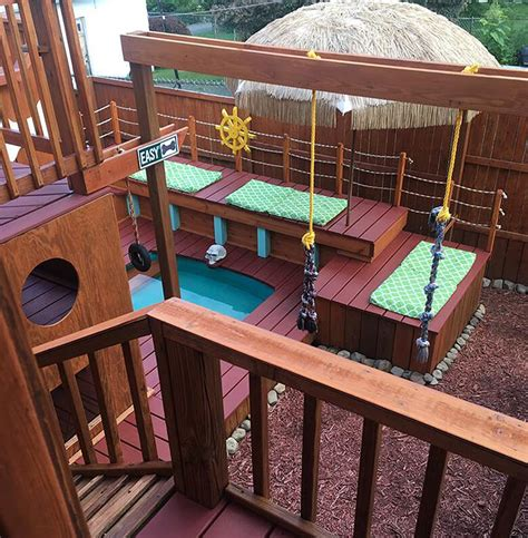 2 level dog house owner builds epic three story playhouse for his dogs