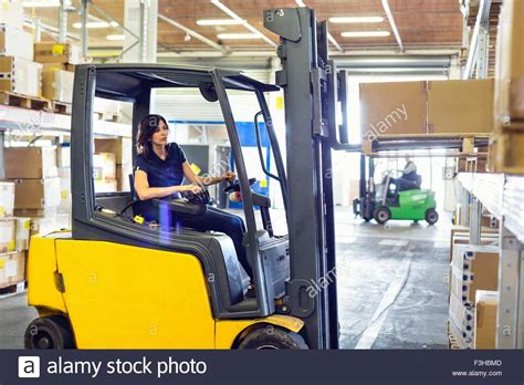 forklift truck driver working in distribution warehouse stock photo royalty free image