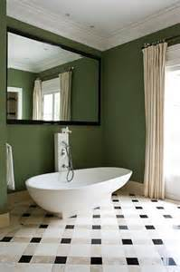 bathroom with green walls calm green wall bathroom with white tub big mirror and