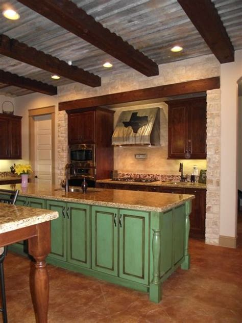 rustic tin ceiling the use of distressed tin for the ceiling along with the wood beams help give this kitchen a