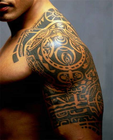 tribal tattoos chest arm shoulder dwayne johnson aka the rock has a tribal on