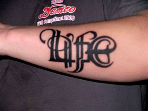 life death tattoo awesome ambigram lettering on forearm