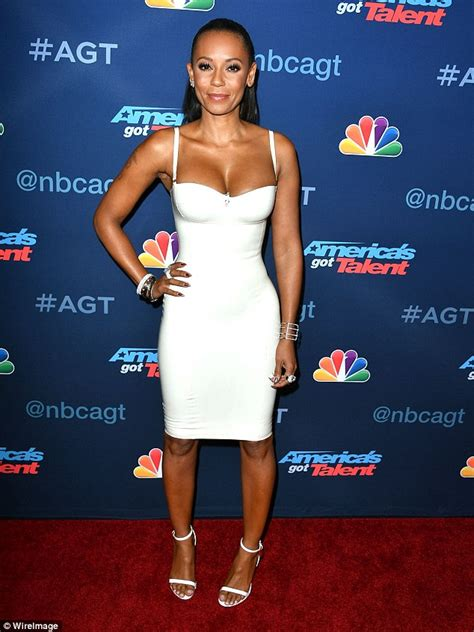 Mel Dress mel b flaunts hourglass figure in low cut white dress at