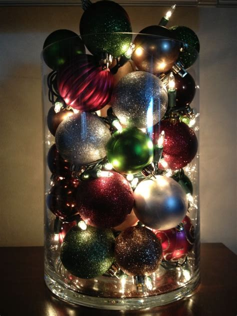 ready made cristmas decorations ornaments and lights inside a large vase