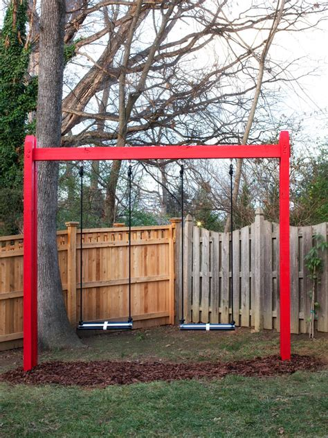 red swing set red backyard photos hgtv