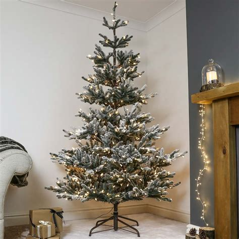 youtubecom snow for artificial christmas tree 7ft pre lit green snow effect real imperial spruce artificial tree