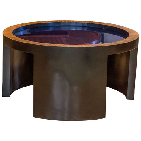 coffee table with cobalt blue glass top attributed