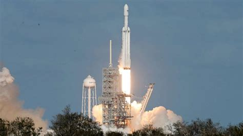 elon musk rocket landing elon musk s spacex launches megarocket with his own tesla