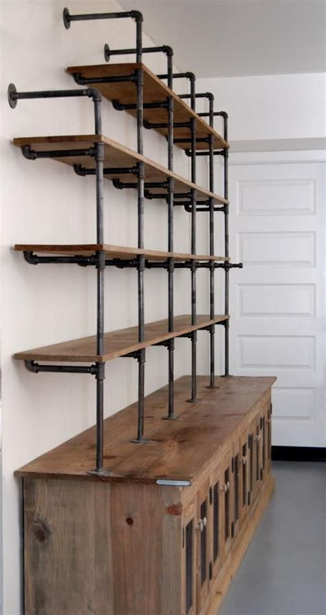 gas pipe shelf and reclaimed wood would be a great media