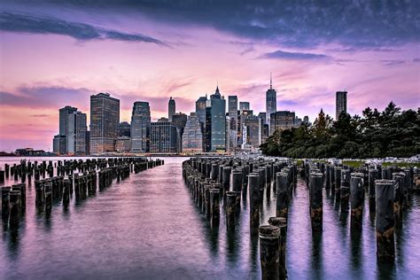 new york city skyline sunset hues photograph by susan candelario