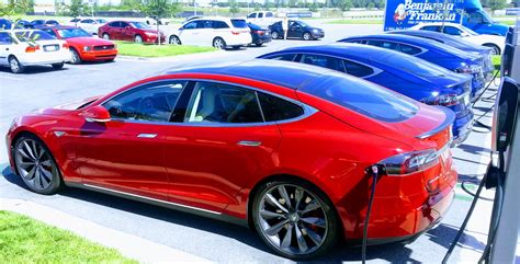 tesla model s charging tesla ceo elon musk plans fix for who don t move