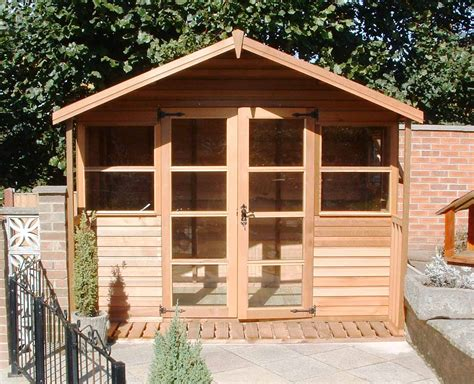 Glass Roof House traditional cedar summerhouse manufacturer