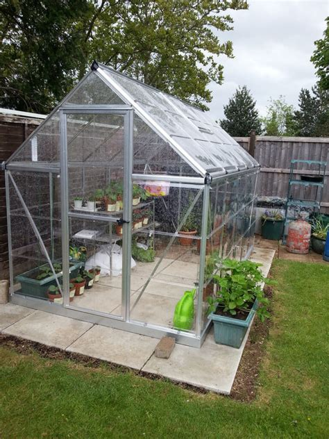 23 wonderful backyard greenhouse ideas