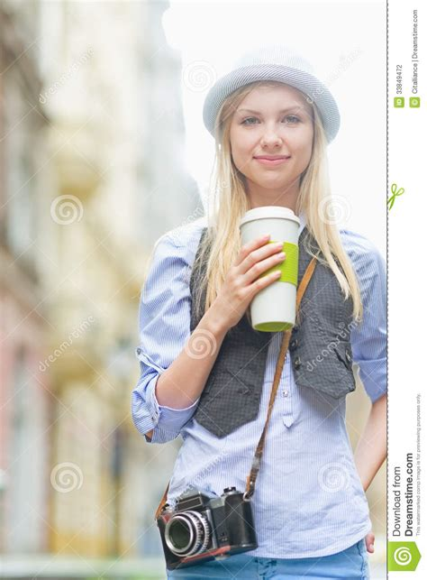 happiest hipster happy hipster girl with cup of hot beverage on city street