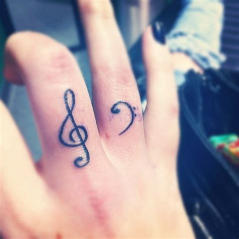 finger tattoo music note 49 stunning finger tattoos