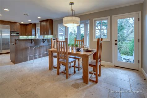 Dining Room Floors | dining room with patterned travertine tile floor