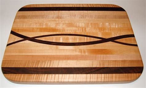 Handmade Designer - handmade maple and walnut curvy cutting board by shanej