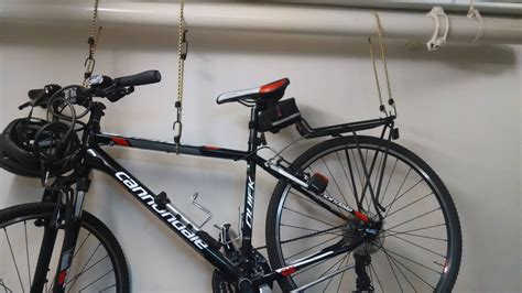 hang bike from ceiling storage best way to hang a bicycle from a ceiling pipe