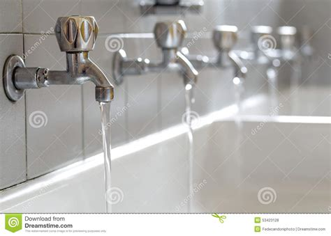 how to clean taps in the bathroom steel taps with drinking water flowing in college bathroom