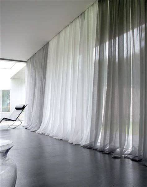 how long should bedroom curtains be modern window treatments pool the long drapes at the