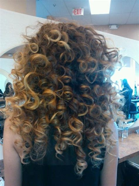 spiral curls toward the face period there was a time when permed hair was all the rage maybe