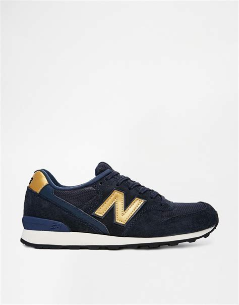 gold new balance sneakers new balance blue and gold style androgynous