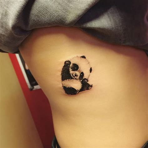 panda chest tattoo girl illustrative panda tattoo on the right side little