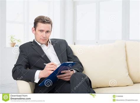 psychology couch male psychologist being ready to take notes royalty free