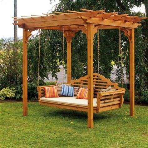 swing backyard garden swing under a small wooden pergola near trees