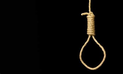 black doll hanging white hangs doll from noose at work to mock