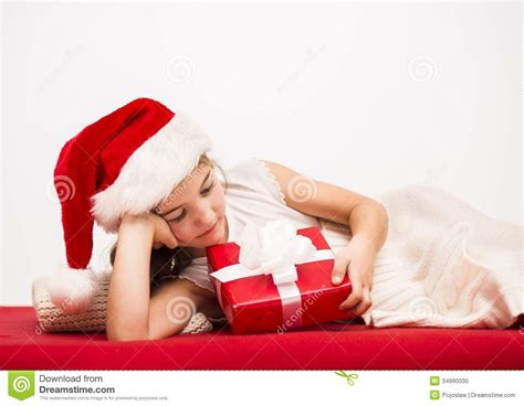 small in santa hat with gift stock photo