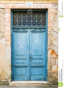 Mediterranean Architectural Style - old rustic wooden doors painted in blue stock photo image 29071406