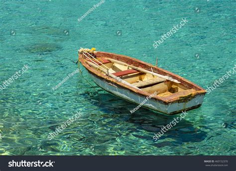 floating boat images wooden fishing boat floating on colourful stock photo