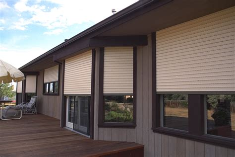 rolling shutters exterior window treatment white sun heat