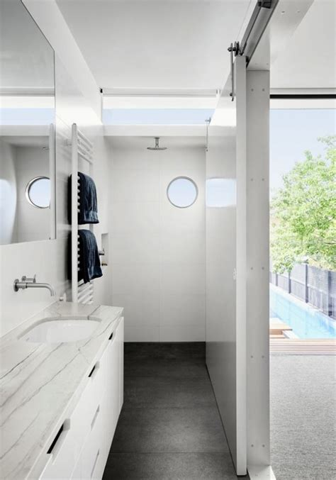 round bathroom window an open home that challenges monolithic architecture