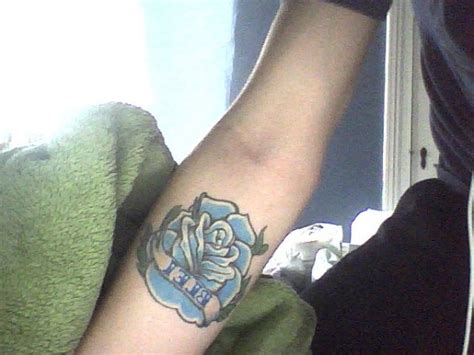 blue rose tattoo meaning blue design on forearm tattoomagz