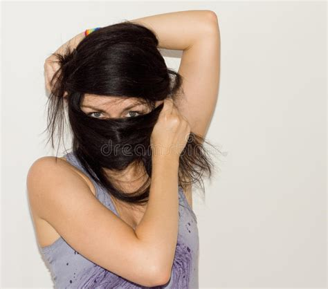 wrapped image of long hair woman wrapping her long hair around her face stock image