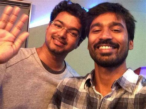 actor vijay number dhanush to pen a number for vijay s kaththi filmibeat