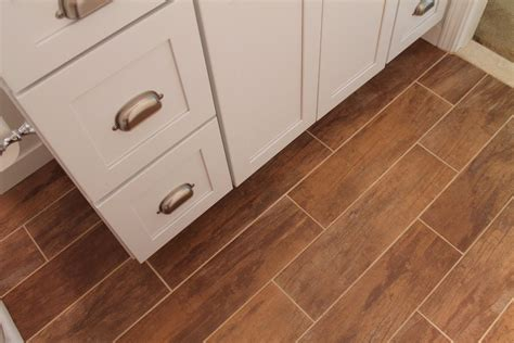 bathrooms with wood tile floors remodelaholic bathroom renovation with wood grain tile