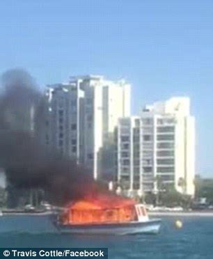 houseboat on fire gold coast gold coast man forced to jump from his boat after it went