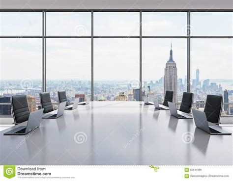 In Nyc For Meetings Today Just In Time For The Re a conference room equipped by modern laptops in a modern
